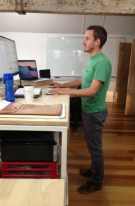 Tom Standing At Desk