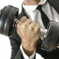 Business Man Lifting Weights (Featured)