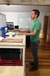 Tom Standing At Desk